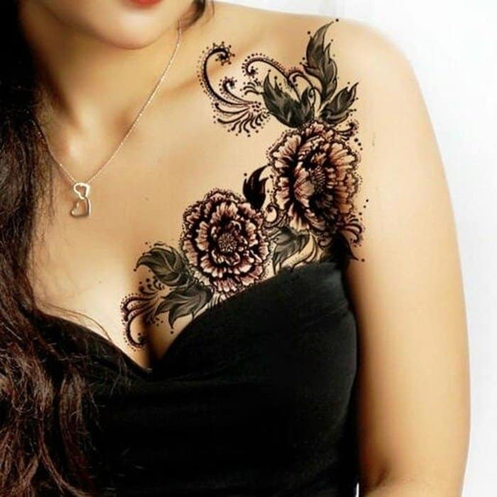 Sexy female chest tattoos